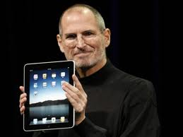 Steve Jobs with revolutionary tablet computer, the iPad.